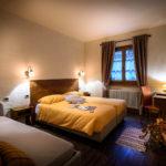 Ostello Tirano – camera arancione – foto Ivan Previsdomini